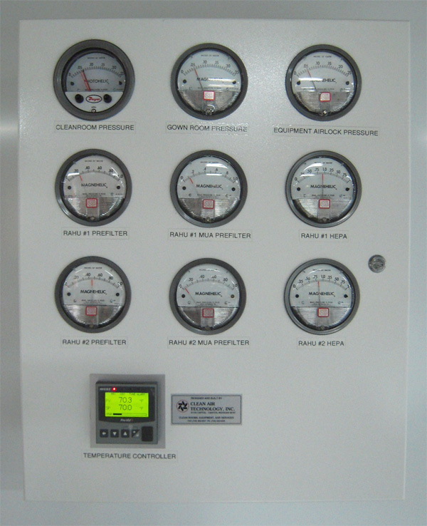 panel with monitors showing pressure